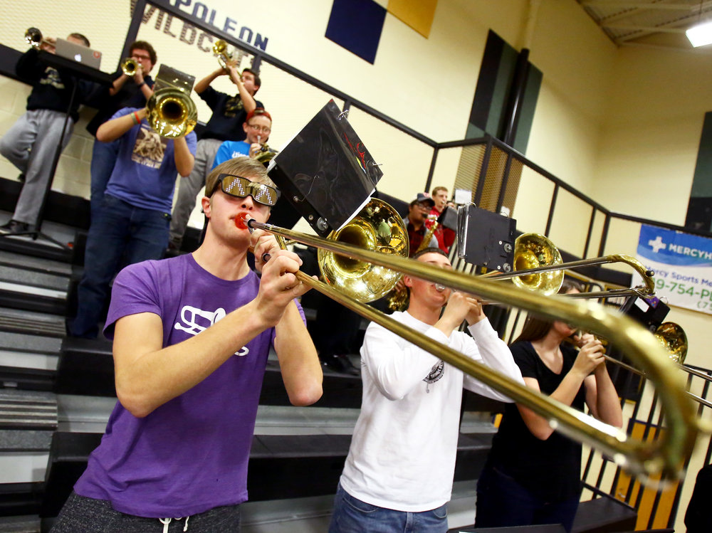 Perrysburg High School junior Nick Wietrzykowski plays the trombone with the pep band during the girl's varsity basketball game against Sylvania Northview High School at Perrysburg High School on Thursday, Dec. 8, 2016.
