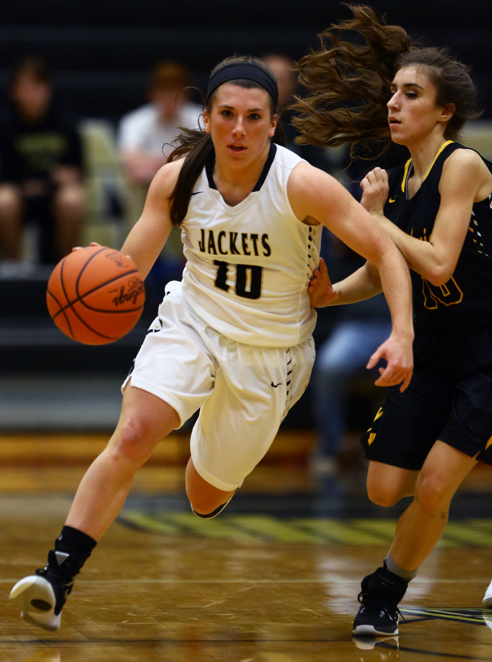 Perrysburg High School guard Kristina DeMarco (10) dribbles the ball down court around Sylvania Northview High School guard Kylie Archibeque during the girl's varsity basketball game at Perrysburg High School on Thursday, Dec. 8, 2016.