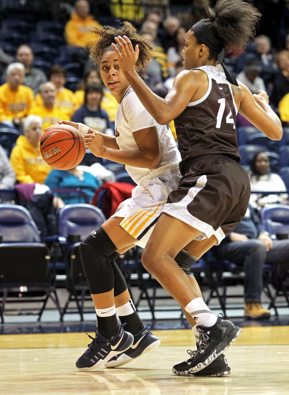 University of Toledo guard Jada Woody (35) looks for an opening around St. Bonaventure forward Gabby Richmond (14) during the women's basketball game at Savage Arena in Toledo, Oh. on Sunday, Dec. 11, 2016.