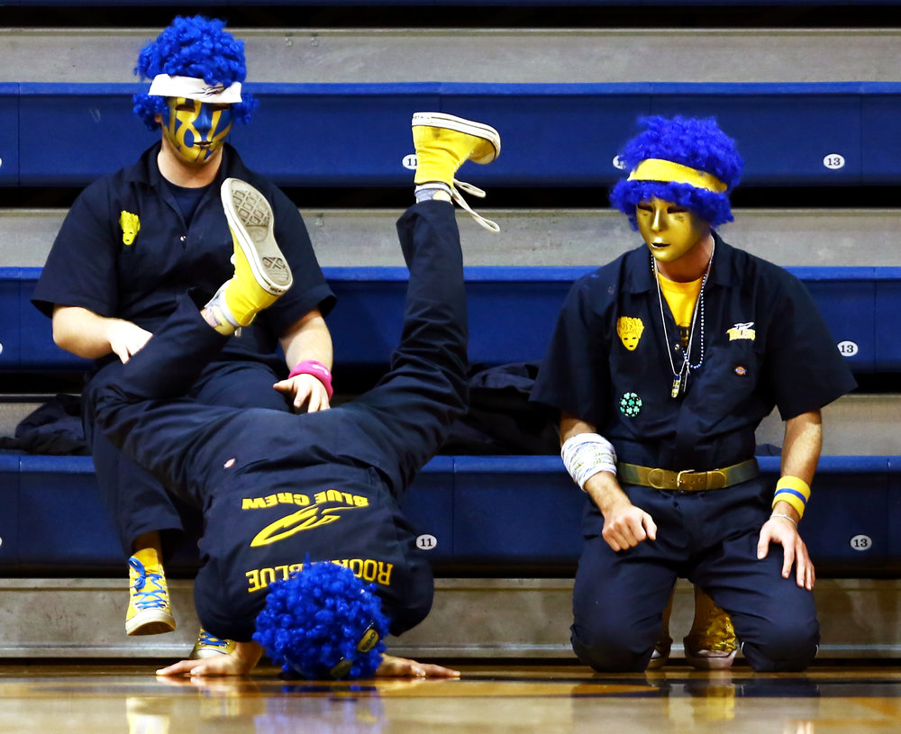 """Rookie Blue"" of the Blue Crew tries to do a hand stand on the sideline of the court during the women's basketball game against St. Bonaventure University at Savage Arena in Toledo, Oh. on Sunday, Dec. 11, 2016. University of Toledo won the game 74-50."