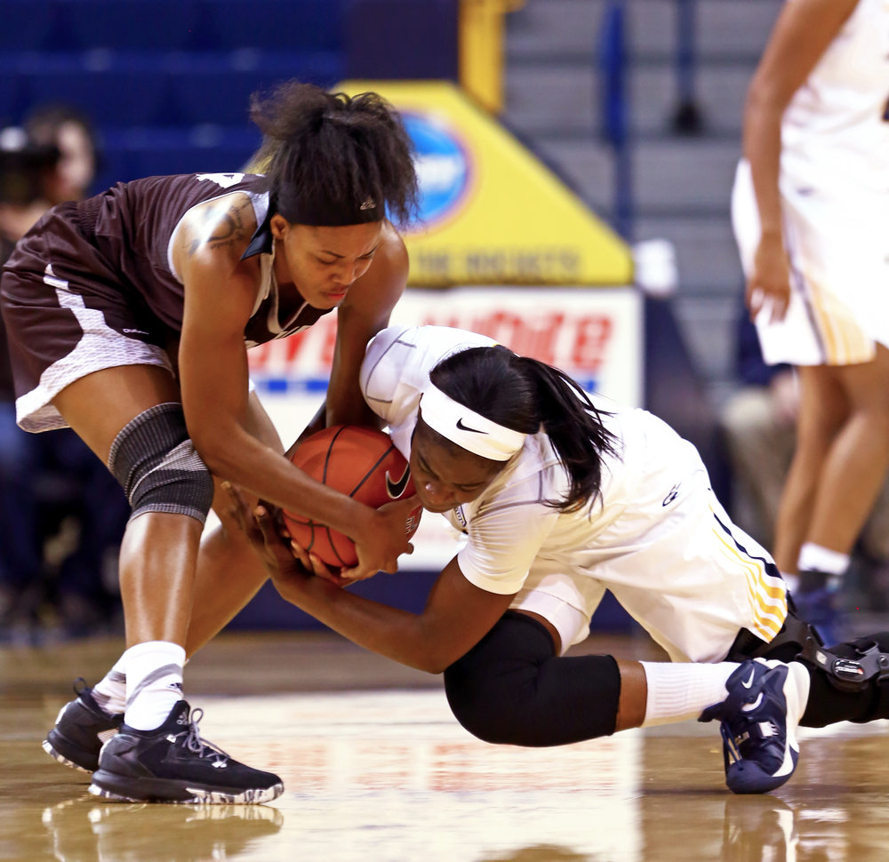 St. Bonaventure forward Gabby Richmond (14) and University of Toledo forward Janice Monakana (12) fight for control of a loose ball during the women's basketball game at Savage Arena in Toledo, Oh. on Sunday, Dec. 11, 2016.