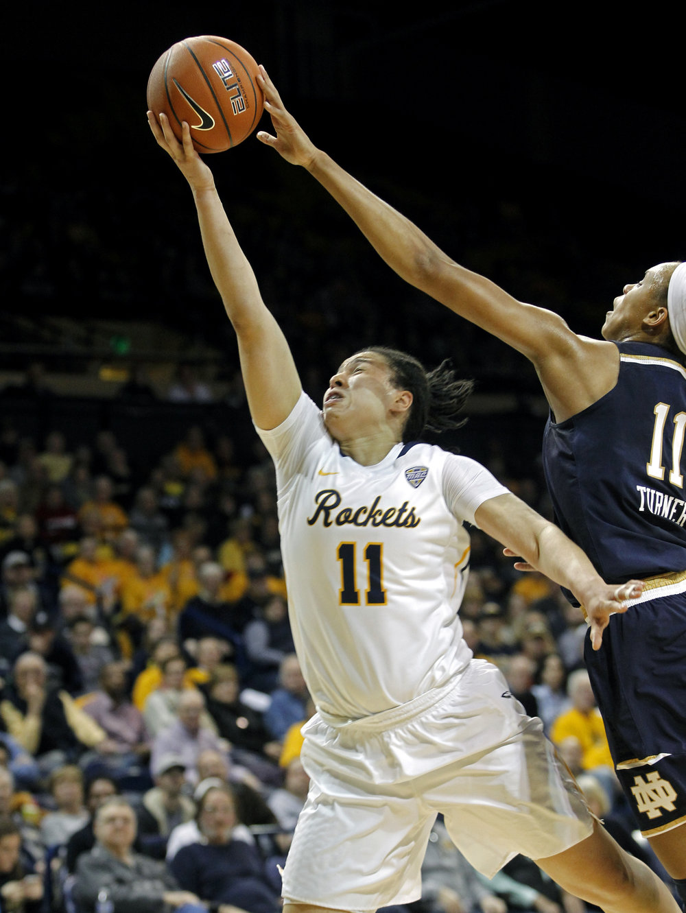University of Toledo guard Jay-Ann Bravo-Harriott's (11) layup is blocked by Notre Dame forward Brianna Turner (11) during the women's basketball game at Savage Arena on the University of Toledo's campus on Sunday, Dec. 18, 2016.