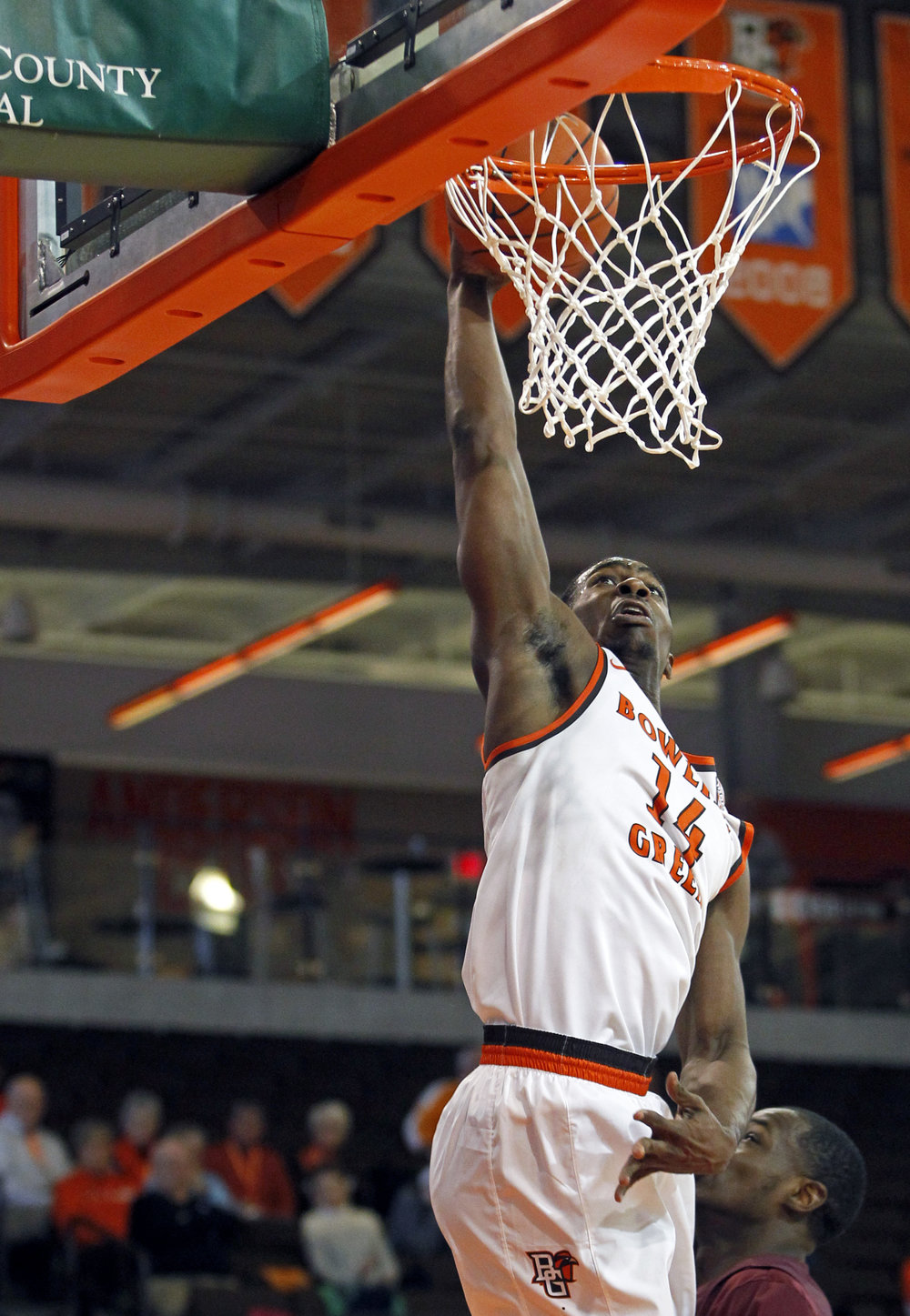 BGSU forward Wes Alcegaire (14) jumps for a slam dunk during the men's basketball game against Alabama A&M at the Stroh Center in Bowling Green, Oh. on Thursday, Dec. 22, 2016. BGSU won the game 74-61.