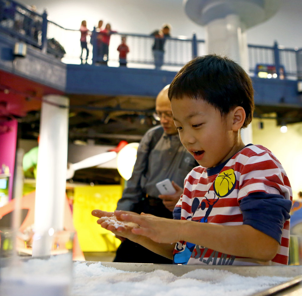 "Neil Huang, 8, of Findlay plays with the ""insta-snow"" at the annual Frostology exhibit put on by the Imagination Station in downtown Toledo, Oh. on Monday, Dec. 26, 2016. The Frostology exhibit explores the science behind snow using demonstrations and activities."