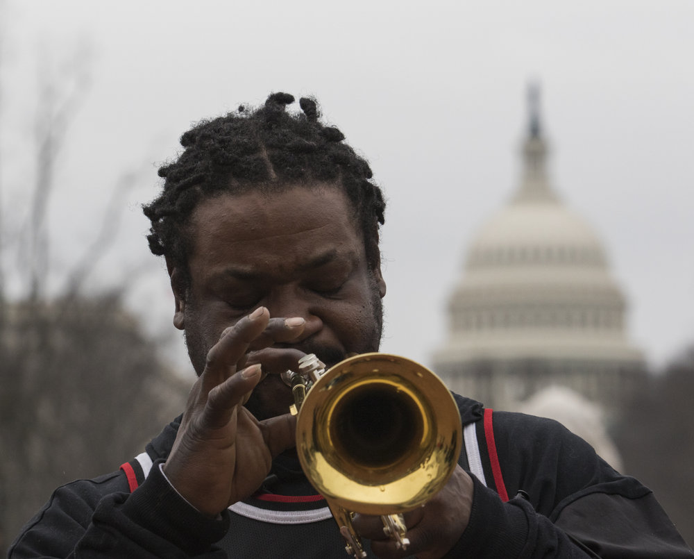 "Melvin Simpson of Washington D.C. plays the ""Star Spangled Banner"" on his trumpet outside of Union Station in Columbus Circle on Friday, Jan. 20, 2016."