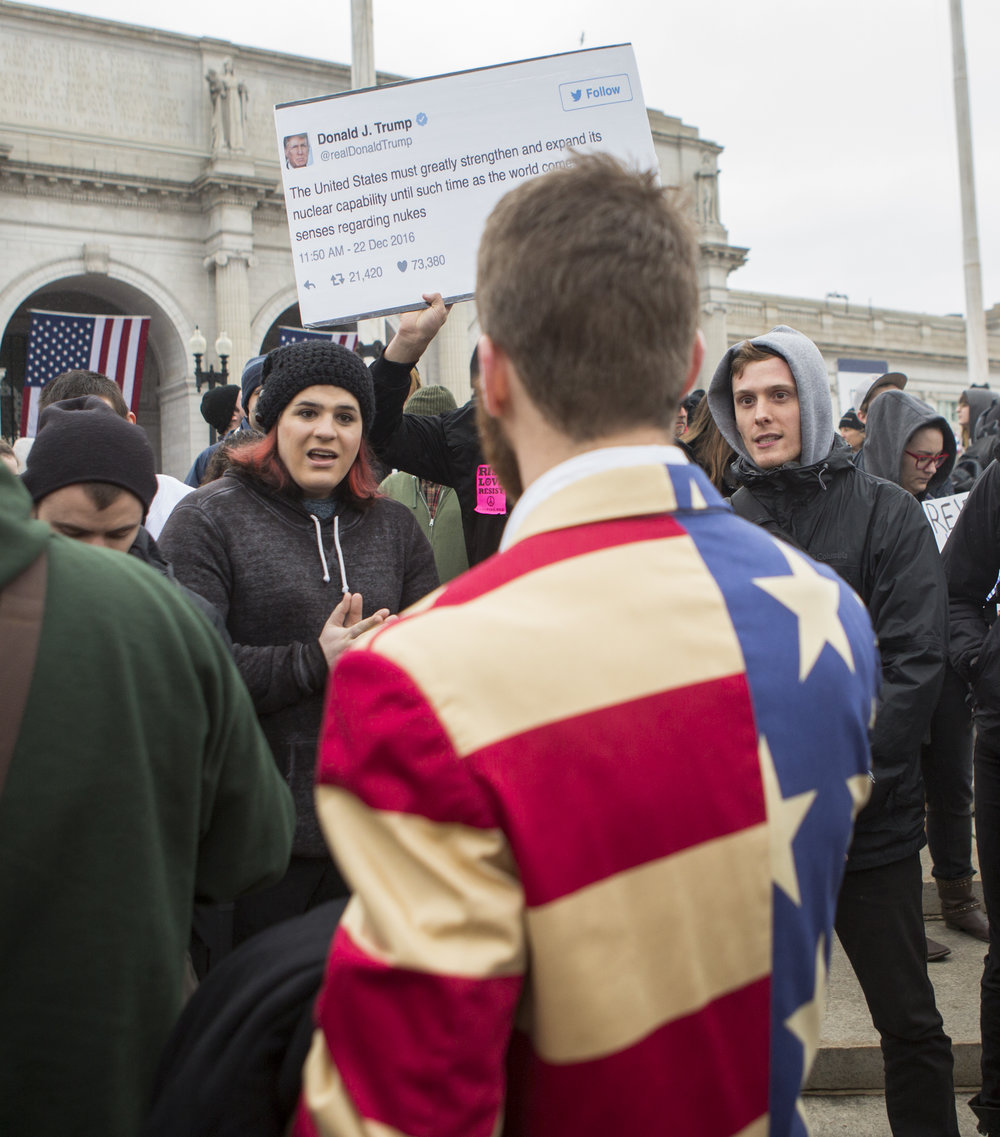 Anti-Trump protesters debate with Nolan Meyer of Newport Beach, Ca. in Columbus Circle outside of Union Station shortly after Donald Trump's inauguration ceremony in Washington D.C. on Friday, Jan. 20, 2016.