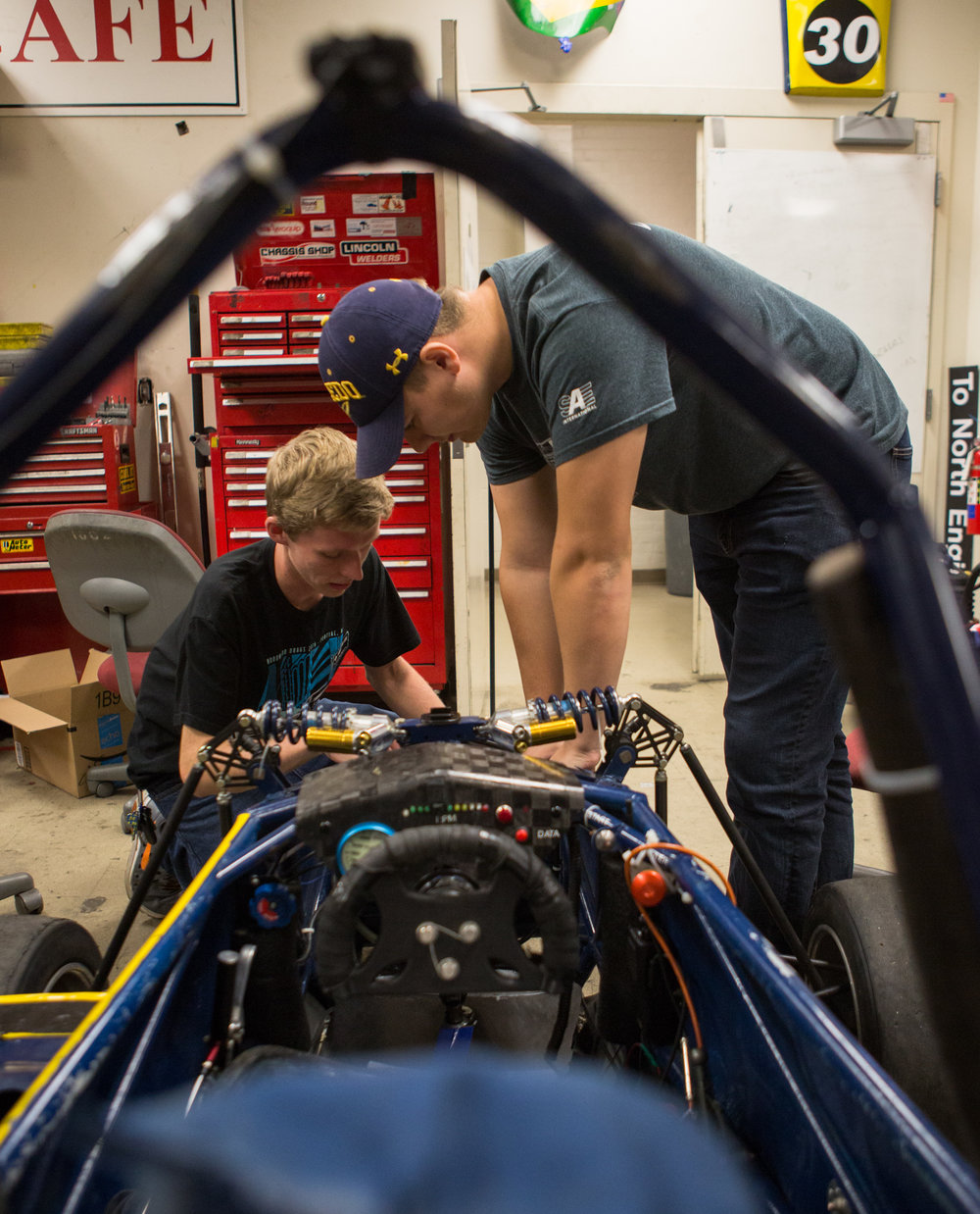 Braking subgroup lead Mike Day, left, and Austin Gant look at the pedal mount design from last year's car as they plan for the current season's car.