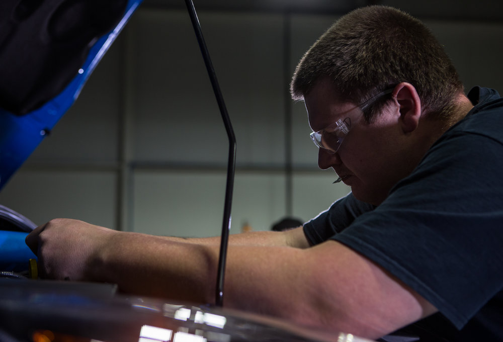 Project engineer Dan Tafe works on installing sensors under the hood of the Ford Focus RS to prepare for dyno testing on Friday, March 31, 2017. Click on the photo to read up on the projects going on for the RS.