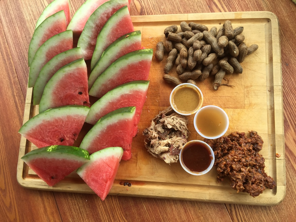 A proper southern picnic: watermelon, boiled peanuts, pulled pork, and chopped brisket.