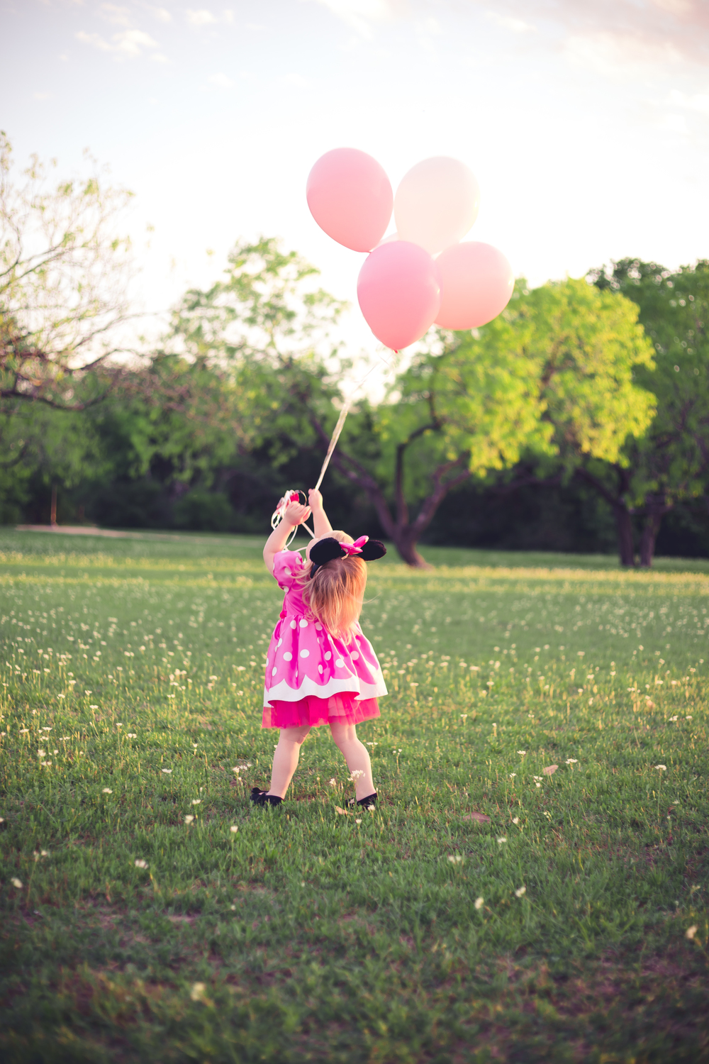Loved getting this candid shot at the end when she got to take the balloons home!