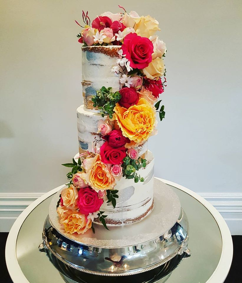3 tier semi naked cake with florals