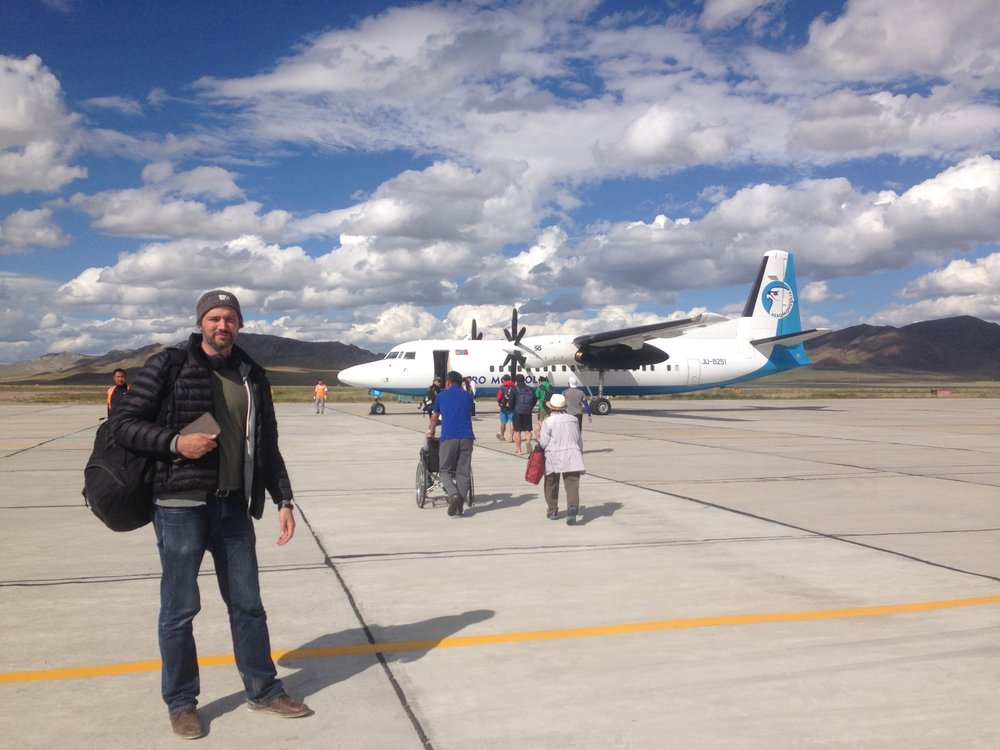 Michael Roscoe about to board an internal flight from the north of Mongolia to the country's capital city, Ulan Bator. Michael produced, directed, filmed and edited 4 videos for Phase One / PODAS during this 10 day shoot.