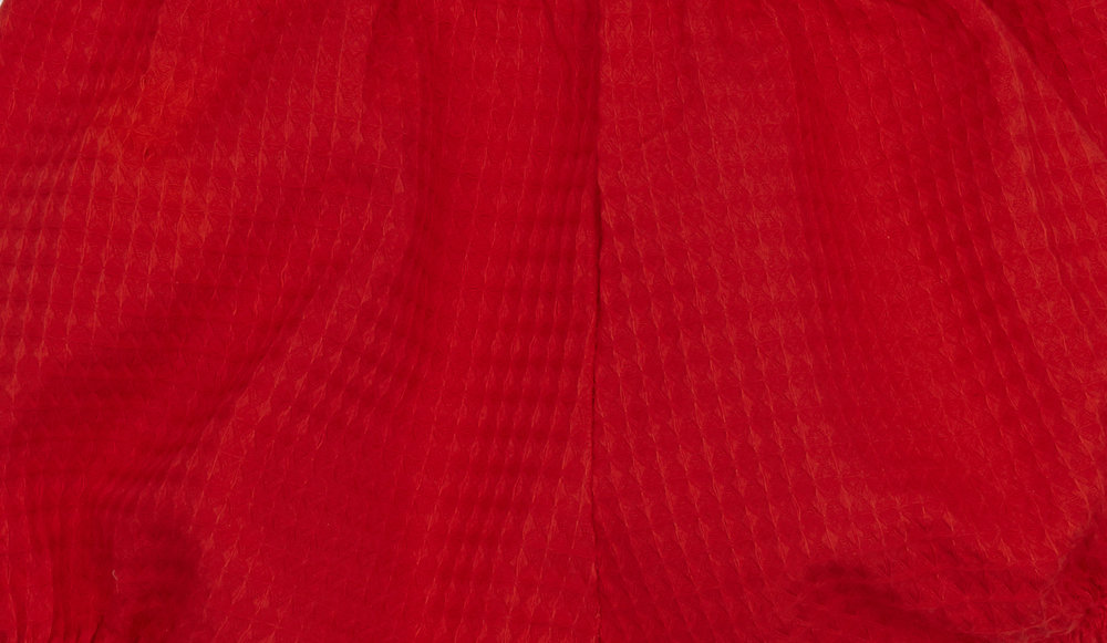 red textured fabric close up.jpg