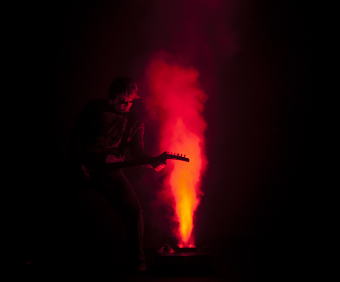 Smoke Jet Geyser with Guitarist in front of smoke
