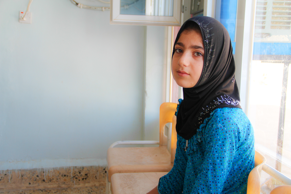 A young Kurdish girl waits in a clinic waiting room, Erbil / For the Iraq mission of the International Organization for Migration