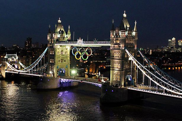 The Olympic rings are lit up on Tower Bridge, London, in preparation for the start of the 2012 London Olympics.jpeg