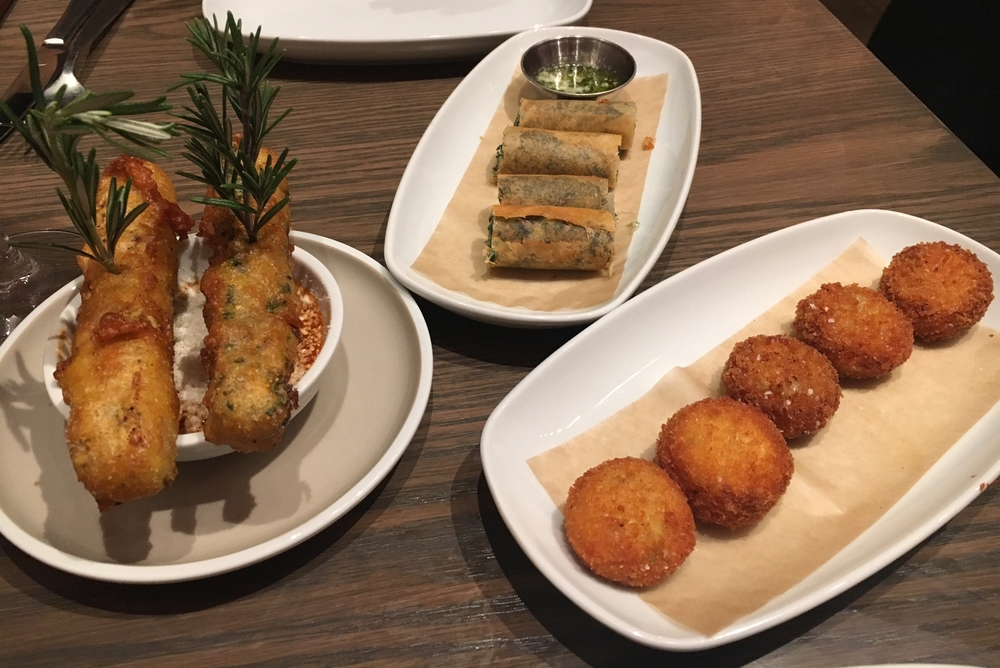 From left to right: Duck Egg Beignets, Snuggled Escargot, Tartiflette Fritters