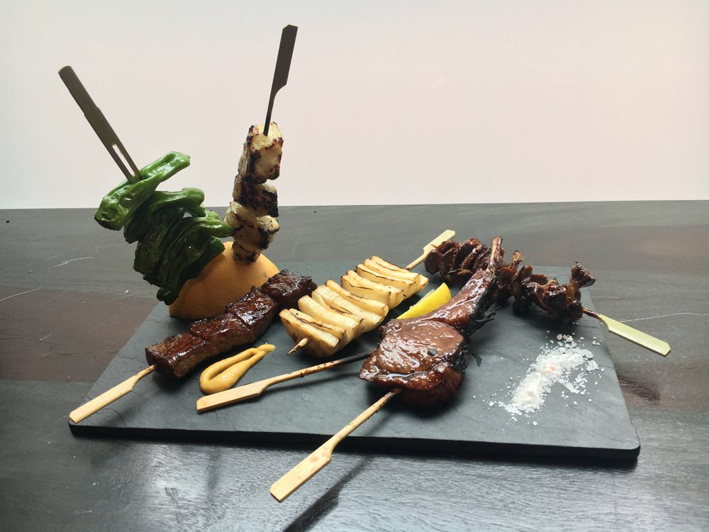 From left: Shishito peppers, Sea Bass, Wagyu Beef, King Oyster Mushroom, Lamb Chop, Chicken Gizzard