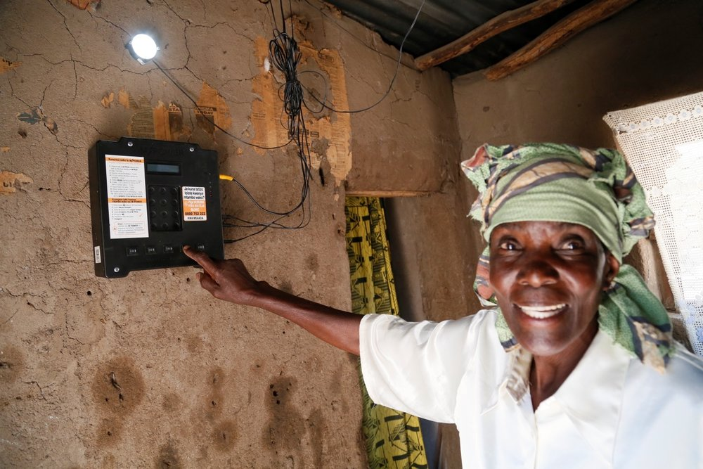 Picture: Flickr. Russell Watkins/Department for International Development. Elizabeth Mukwimba is a 62-year-old woman who now has solar lighting and electricity in her home at the flick of a switch, thanks to a scheme backed by UK aid. Elizabeth has had an M-Power solar panel and lights fitted in her home by Off Grid Electric, a private sector company dedicated to providing sustainable, affordable energy to people in developing countries who aren't connected to the electricity grid.