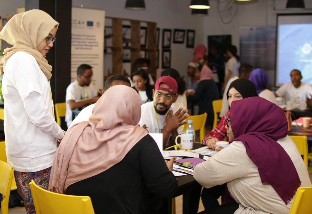 Participants working on their innovative solutions to climate challenges. Photo by Daftar Studios