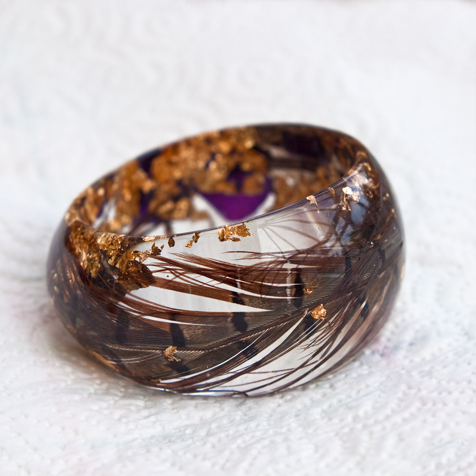 Custom Bangle & Necklace: featuring wedding bouquet flowers & pheasant feathers - I absolutely love my resin jewellery! I asked Gillian to make jewellery from my wedding bouquet, she took the time to design pieces that really complimented my flowers and listed all the details I wanted, and communicated every step of the way.After about 3 weeks I received a beautifully crafted unique keepsake and heirloom from my wedding.- Ursula, Ireland