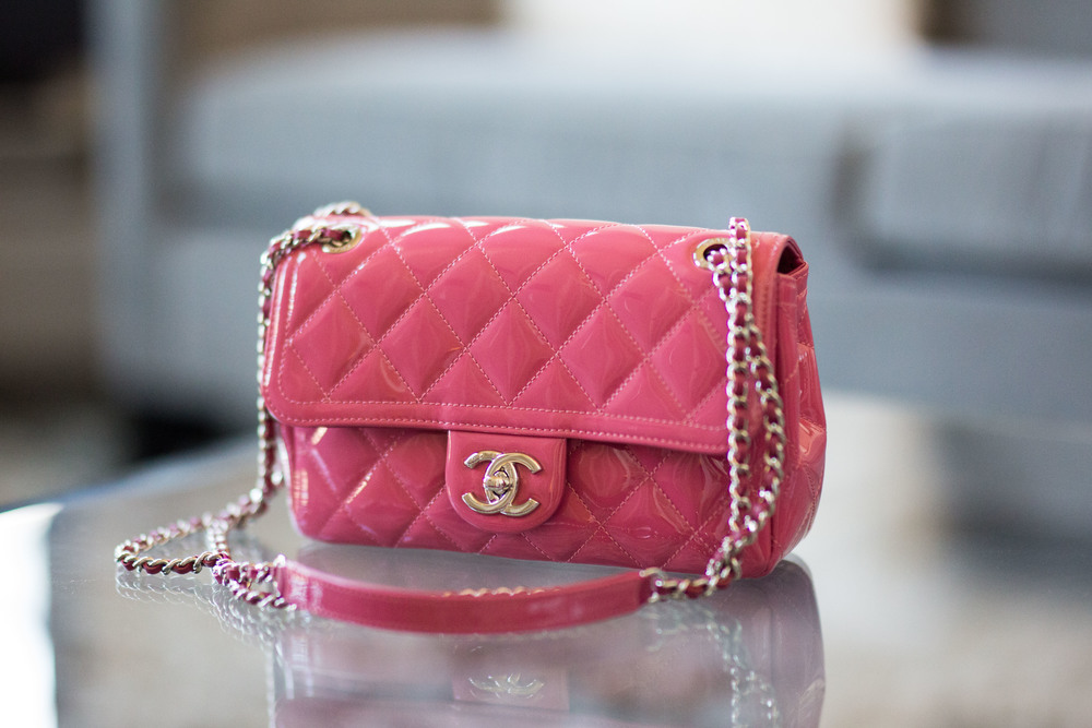 728bb5edc3b L. owns two Chanel flap bags, one classic and one seasonal. Chanel flap bags  range in size from extra mini to maxi, and the two in L.'s closet are maxi  and ...
