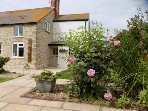 Barn Cottage terrace with roses June 2017.jpg