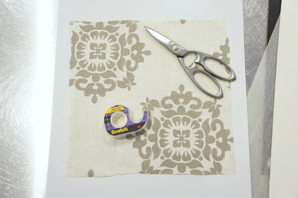 Tape fabric to paper backing