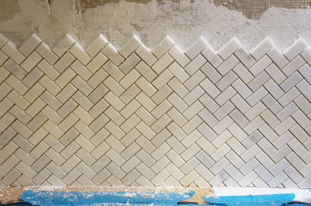 Herringbone marble backsplash tile