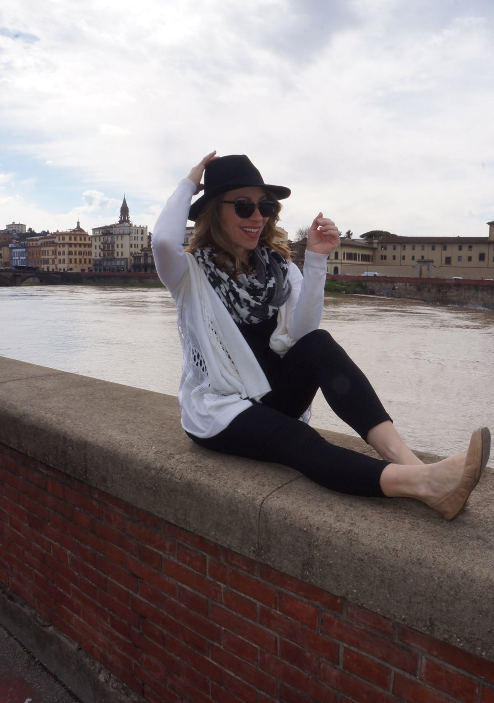 anne along the Arno river in Florence