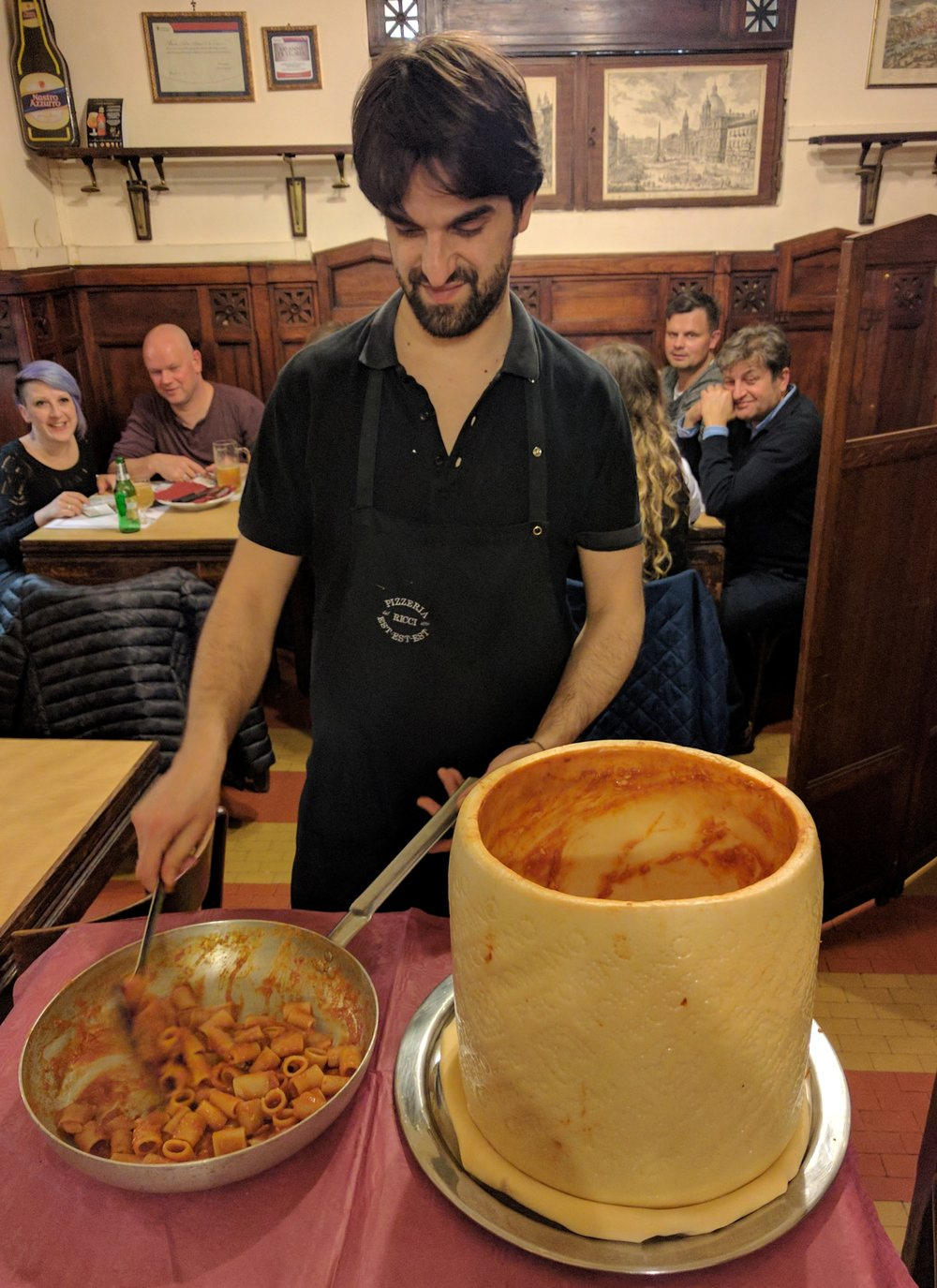 pasta cooked in a wheel of parmesan cheese in rome