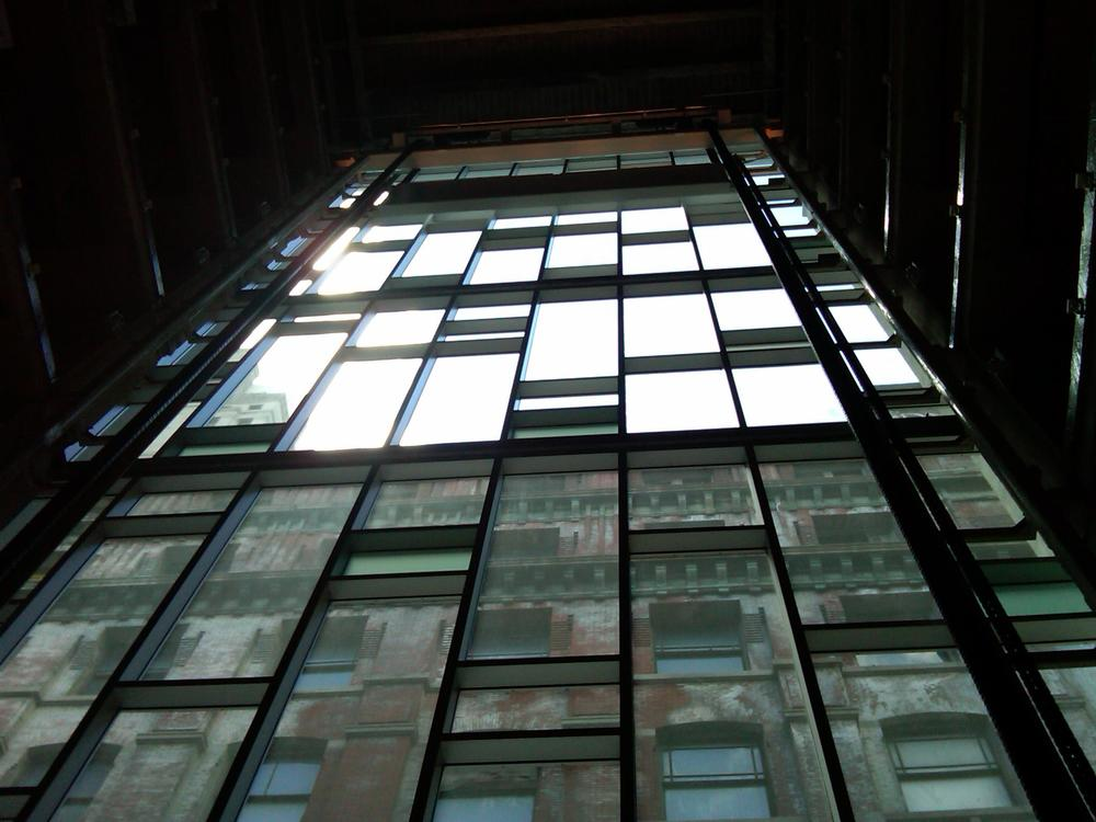 Glass wall inside hoistway