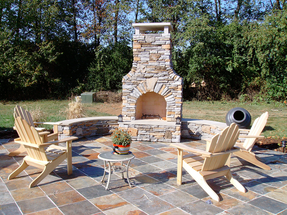 Custom designed outdoor rooms wood fireplace kitchen for Outdoor patio fireplace ideas