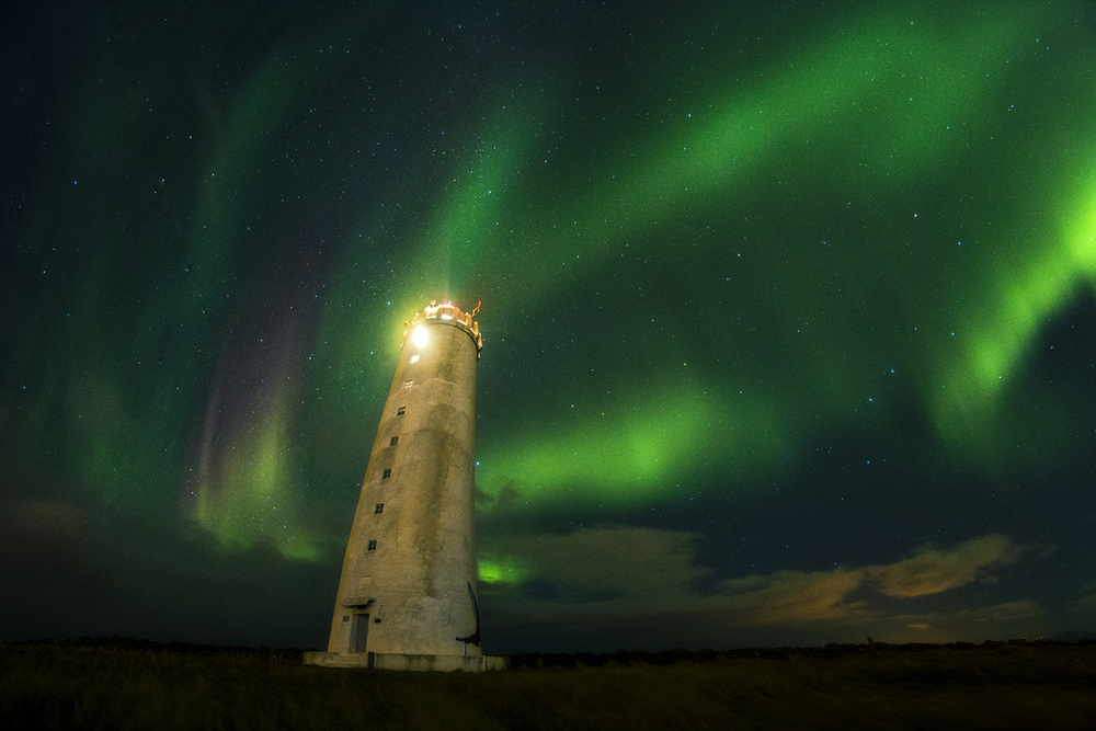lighthouse northern lights iceland thisworldexists this world exists eric bennett things to do before you die