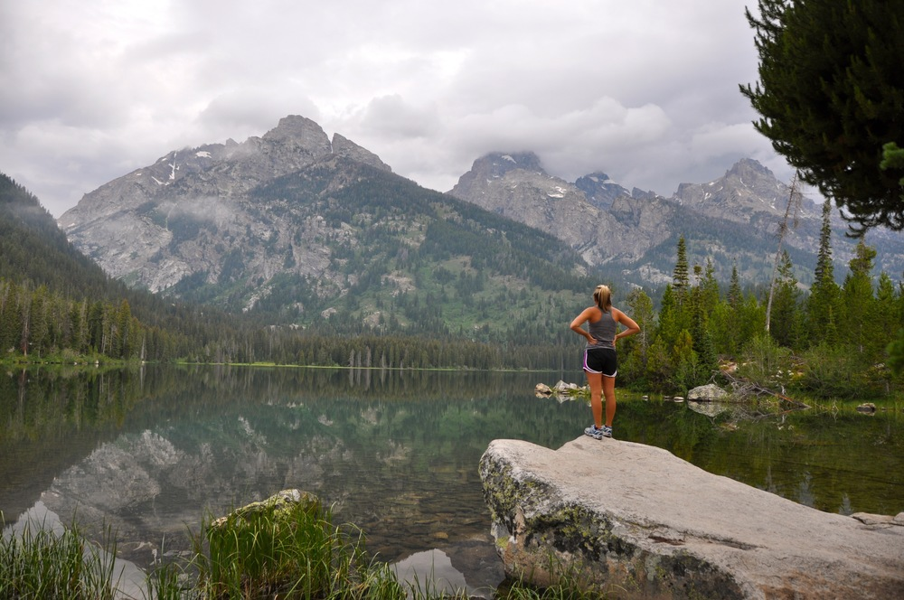 My college friend Kayleigh looking at Taggart Lake after a morning hike in Grand Teton