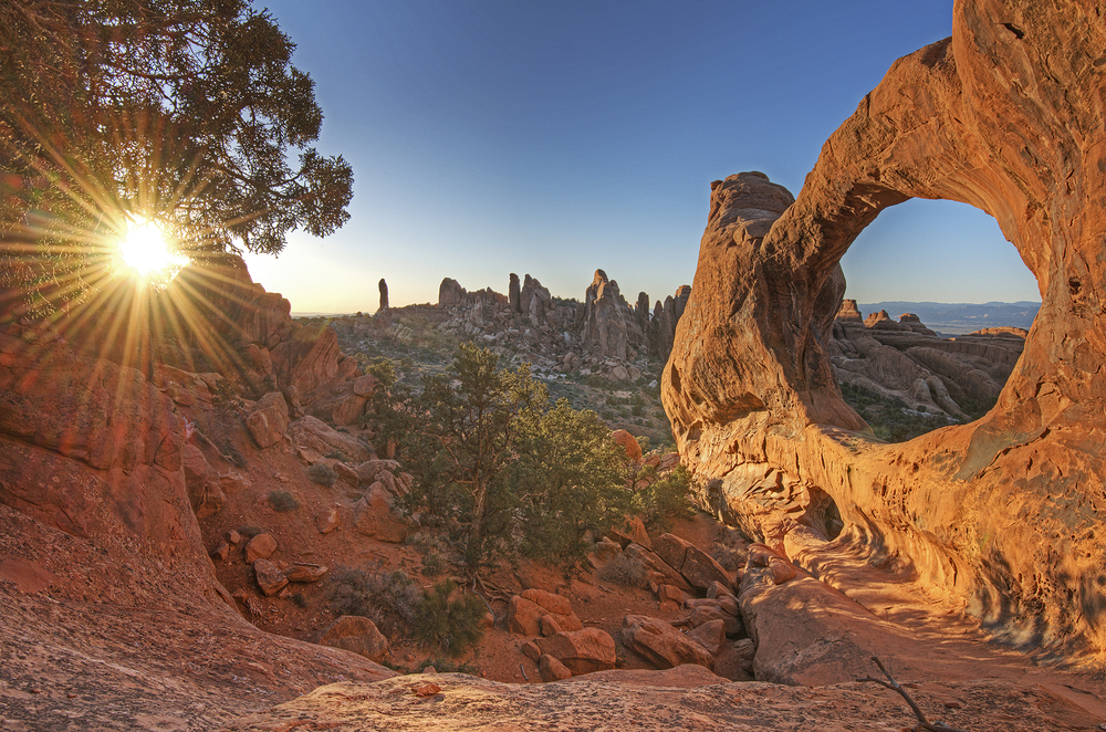 sunset devils garden arches national park arch utah thisworldexists this world exists kyle jenkins