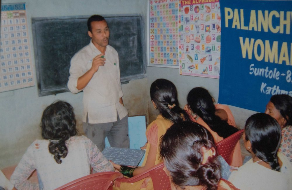 NIRMAL THAPA DELIVERING NIGHTLY EDUCATION SESSIONS TO THE WOMEN OF PALU BARI VILLAGE.