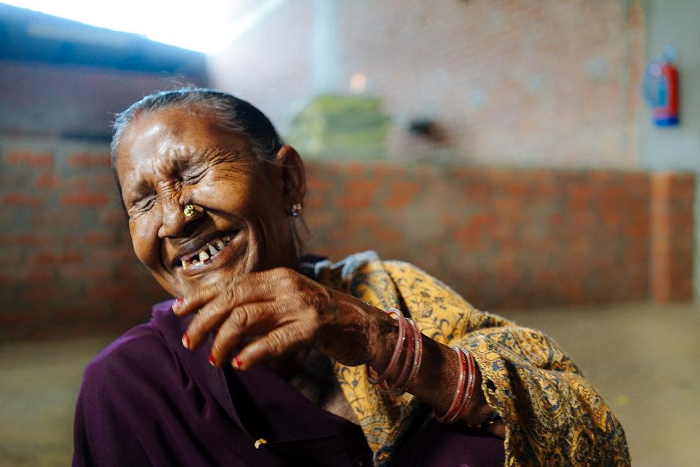 Prakash Rani laughing during her lunch break.