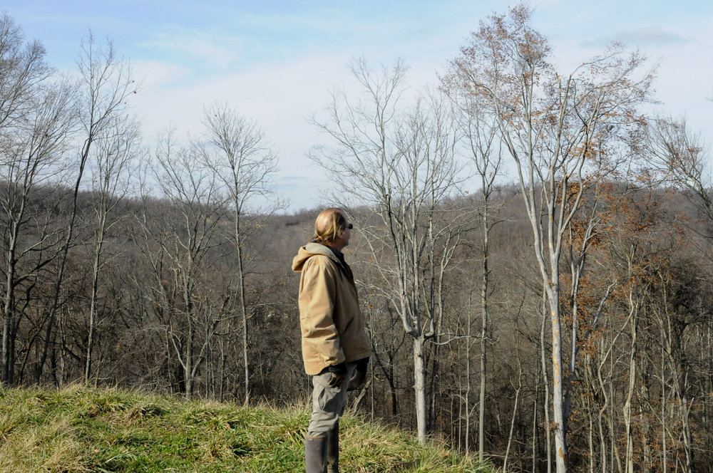 Scott stands on top of his land. In front of him, his home. Behind him, the largest frack pad in Ohio.