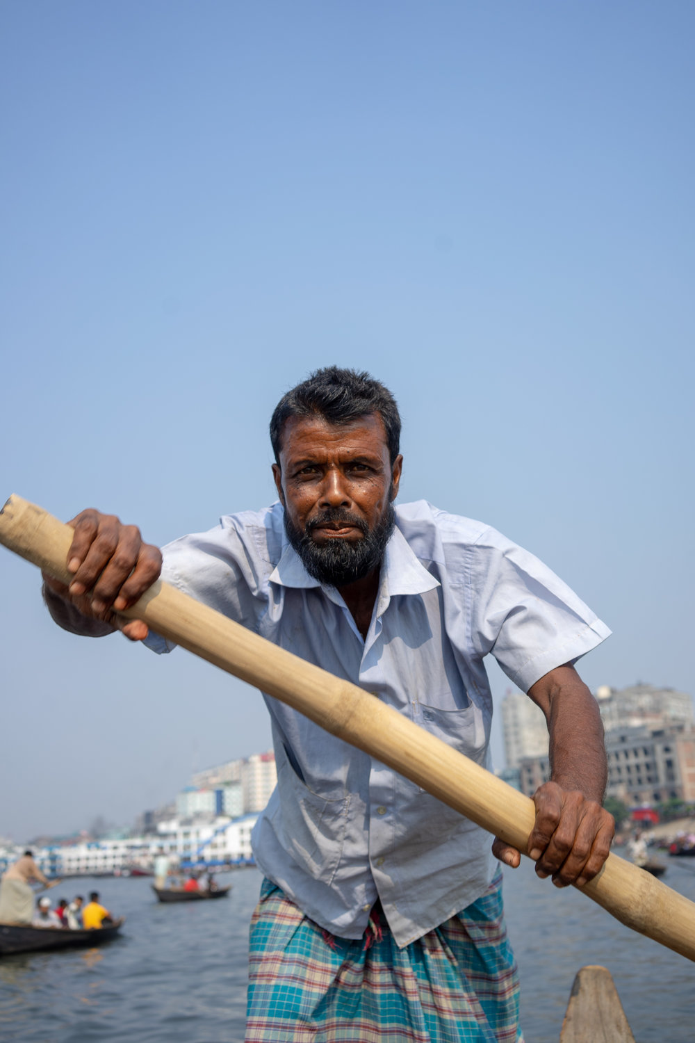 Sultan, from Barishal. He has been working on the boats in Dhaka for 20 years.