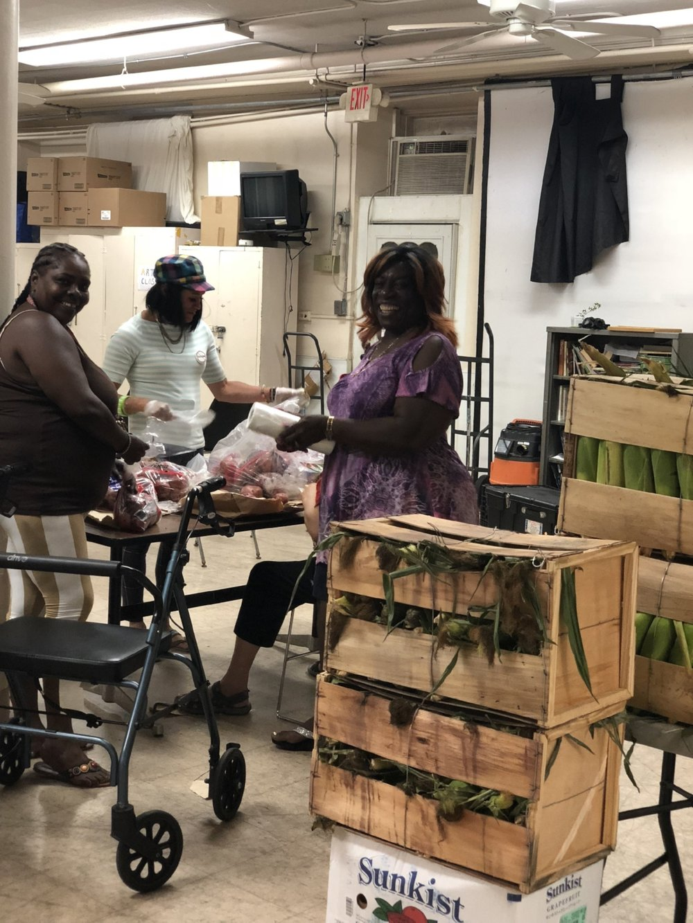 FOOD PANTRY - Volunteers of our food pantry program, dressing vegetables.