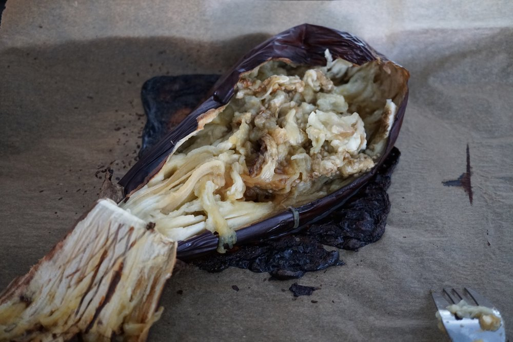 the eggplant will separate easily from the skin and the pieces that don't can be scraped with a fork.