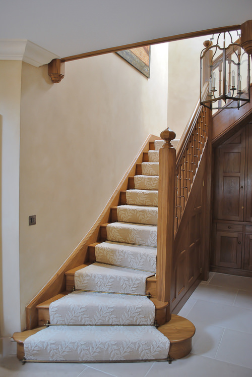 Oak Staircase with Tudor inspired shapes and under stair panelled cupboard