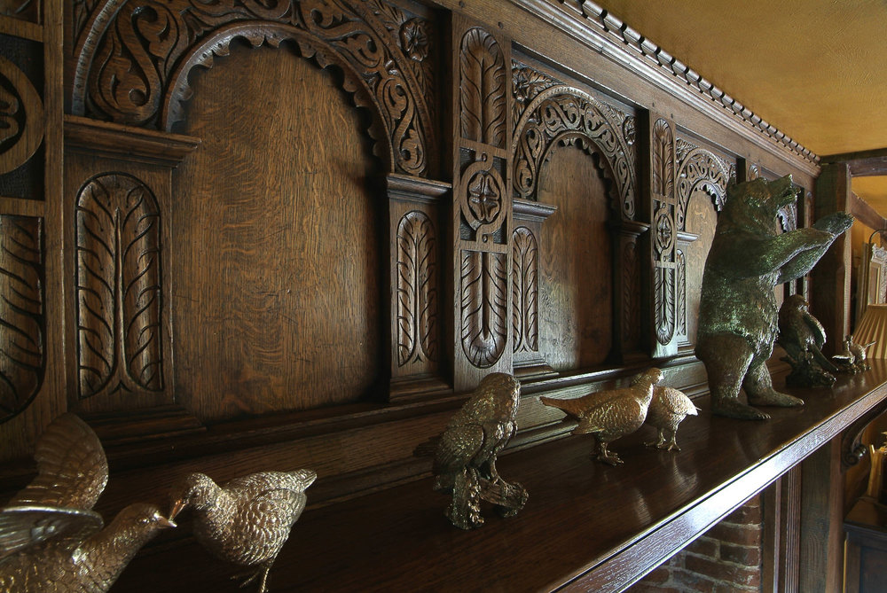 Solid oak Tudor style carved fire overmantel
