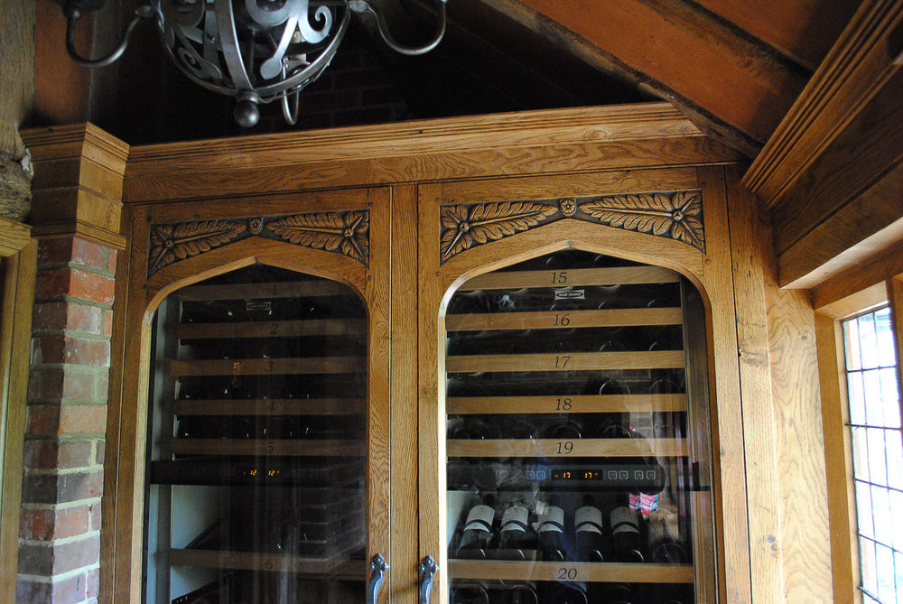 Bespoke wine room with Tudor style carving