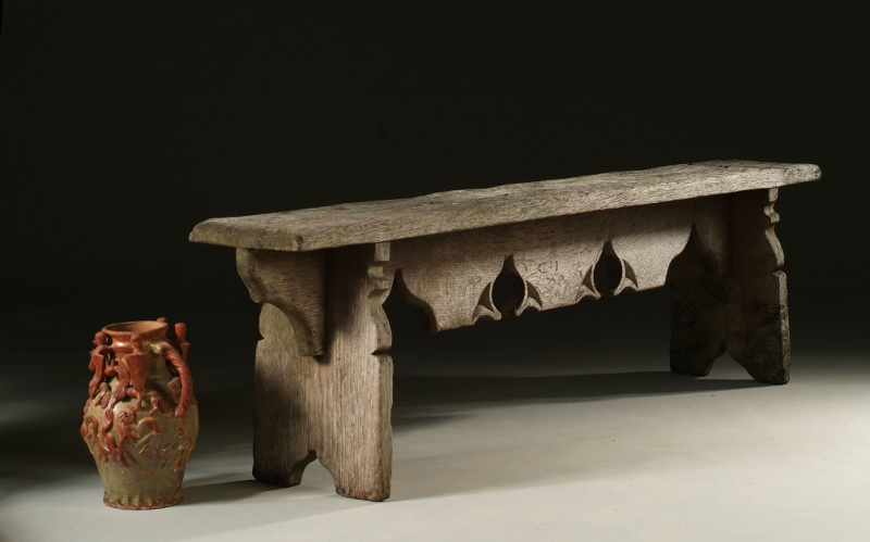 Gothic style oak bench with a weathered finish
