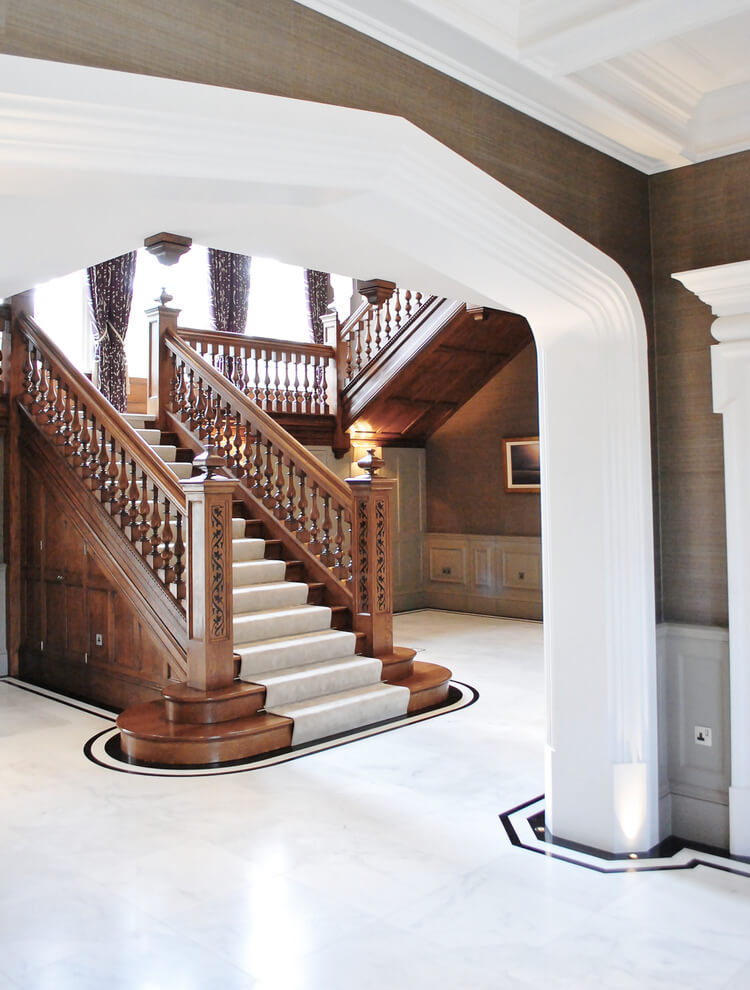 Lower Staircase With Bullnose Treads In The Entrance Hall With Painted  Arches And Door Surrounds.