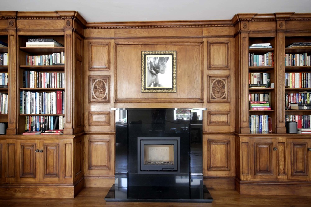 Georgian style oak panelled fire surround and carved panels