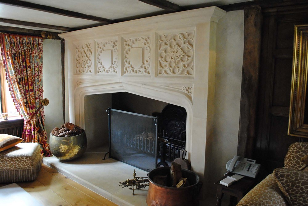 Large full height Gothic style fireplace made in Portland stone