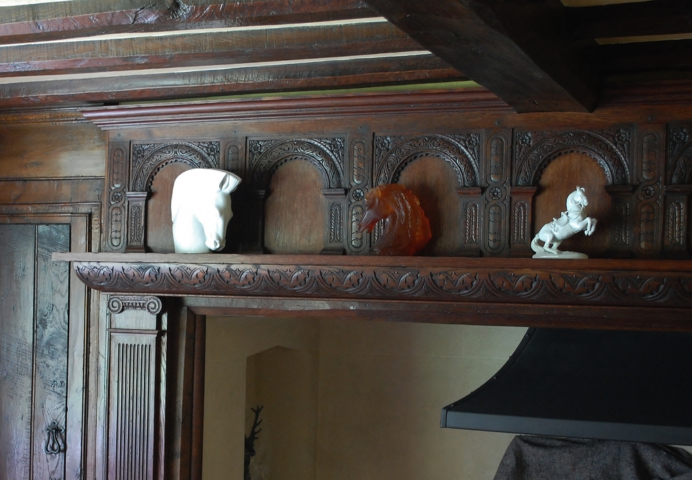 17th century style fire surround with carved arches